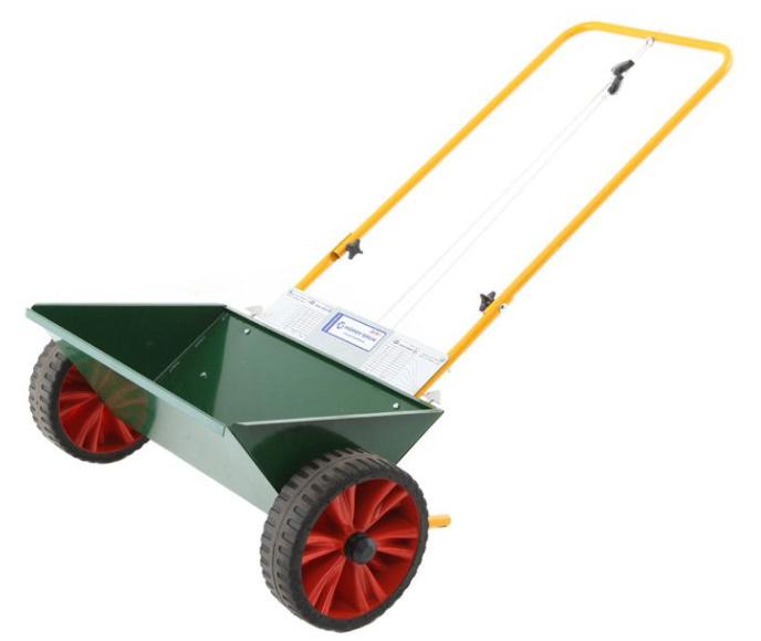 Såmaskin avsedd för gräsfrö och gödning.